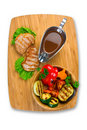 Grilled meat with tomato sauce and vegetables Stock Photos