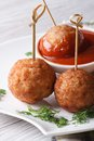 Grilled meatballs nd tomato sauce on a white plate vertical skewers and macro Stock Photography