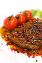 A grilled peppercorn - steak with tomato lettuce Royalty Free Stock Photo