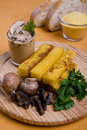 Grilled polenta fingers with mushrooms Stock Image