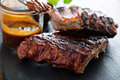 Grilled pork baby ribs with bbq sauce Royalty Free Stock Photo