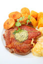 Grilled pork chop baked potatoes and pumpkins on the white plate Stock Image