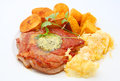 Grilled pork chop baked potatoes and pumpkins on the white plate Royalty Free Stock Photos