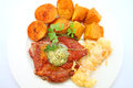 Grilled pork chop baked potatoes and pumpkins on the white plate Stock Photo