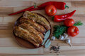 Grilled pork chop with bay leaf, pepper, garlic and dill on wooden board Royalty Free Stock Photo
