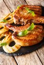 Grilled pork chop in honey glaze served with pineapple and basil Royalty Free Stock Photo