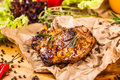 Grilled pork chop with spices and herbs Royalty Free Stock Photo