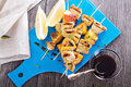 Grilled pork kabobs with peaches served on a cutting board Royalty Free Stock Photo
