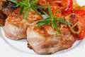 Grilled pork medallions, mushrooms, peppers, tomatoes Royalty Free Stock Photo