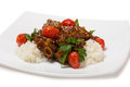Grilled pork ribs glazed with a spicy sauce rice and cherry tomatoes Stock Images
