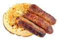 Grilled Pork Sausages On A Buttered Crumpet Royalty Free Stock Photo