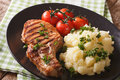 Grilled pork steak with garnish mashed potatoes and tomatoes clo Royalty Free Stock Photo