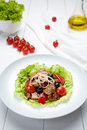 Grilled pork warm salad with sauce, tomatoes, champignon mushrooms, pepper Royalty Free Stock Photo