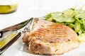Grilled porkchop with side salad on white Royalty Free Stock Photography