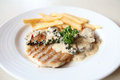 Grilled Porkchop with white sauce Stock Photo
