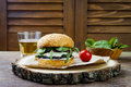 Grilled portobello mushroom burger. Healthy veggies hamburger with onions, arugula, cheese, spicy pickled hot peppers Royalty Free Stock Photo