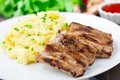 Grilled ribs with mashed potato on a plate Stock Photo