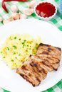 Grilled ribs with mashed potato on a plate Royalty Free Stock Photography