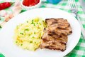 Grilled ribs with mashed potato on a plate Royalty Free Stock Photos