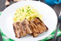 Grilled ribs with mashed potato on a plate Stock Image