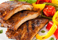 Grilled ribs tasty with vegetables Stock Image
