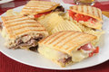 Grilled roast beef panini with potato chips Stock Images