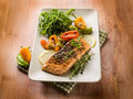 Grilled salmon capsicum arugula Royalty Free Stock Image