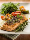 Grilled salmon capsicum arugula selective focus Royalty Free Stock Image