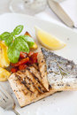 Grilled salmon filet with baked potatoes Stock Image