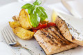 Grilled salmon filet with baked potatoes Stock Images