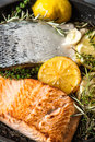 Grilled salmon fish with herbs, garlic and lemon. Healthy seafood Royalty Free Stock Photo
