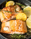 Grilled salmon with herbs, garlic and lemon. FIsh food Royalty Free Stock Photo