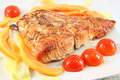 Grilled salmon with herbs tomatoes and papaya Royalty Free Stock Image