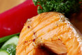 Grilled salmon steak delicious with vegetables shallow depth of field Royalty Free Stock Photo