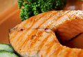 Grilled salmon steak delicious with vegetables shallow depth of field Royalty Free Stock Photography