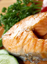 Grilled salmon steak delicious with vegetables shallow depth of field Royalty Free Stock Images