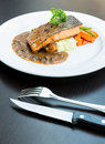 Grilled salmon steak with pepper sauce Royalty Free Stock Image