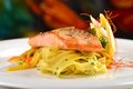 Grilled salmon steak on ribbon pasta Royalty Free Stock Image