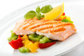 Grilled salmon and vegetables fish dish roasted Royalty Free Stock Image
