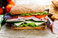 Grilled Sandwich with lettuce, slices of fresh tomatoes, cucumber, red onion, ham and cheese. Royalty Free Stock Photo