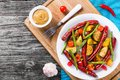 Grilled sausage with garlic, potato, cherry tomatoes, green beans, top-view Royalty Free Stock Photo