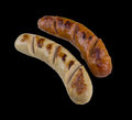Grilled sausage steak isolated on the black background with clipping path Royalty Free Stock Photo