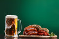 Grilled sausages with glass of beer Royalty Free Stock Photo