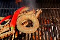 Grilled sausages xxxl and red chili pepper on the bbq Royalty Free Stock Photo