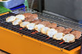 Grilled scallops on flaming grill select focus Royalty Free Stock Photos