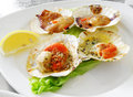Grilled scallops seafood with lemon Royalty Free Stock Photography