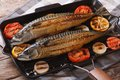 Grilled sea fish and vegetables in a pan grill, horizontal Royalty Free Stock Photo