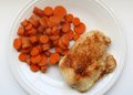 Grilled seasoned chicken and carrots breast with boiled on a white plate Royalty Free Stock Photography