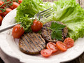 Grilled seitan with tomatoes Royalty Free Stock Photos