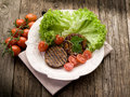 Grilled seitan with tomatoes Stock Image